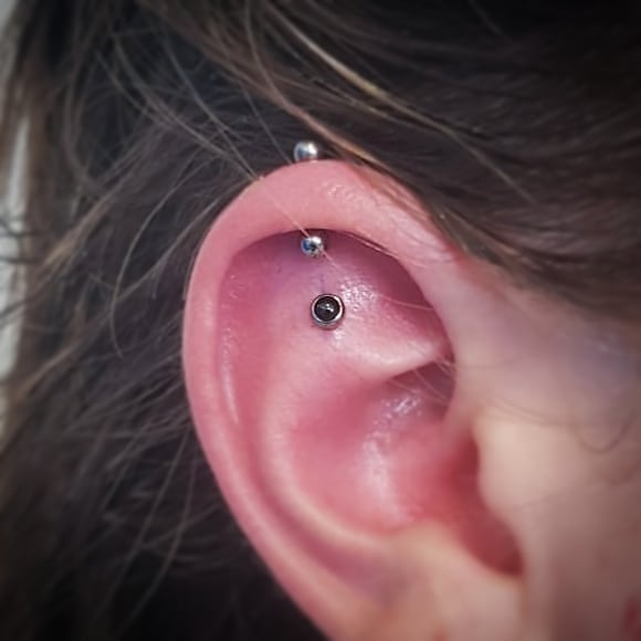 Freshly done by Zavo with a Industrial Strenght black cabocon end! Healed helix-